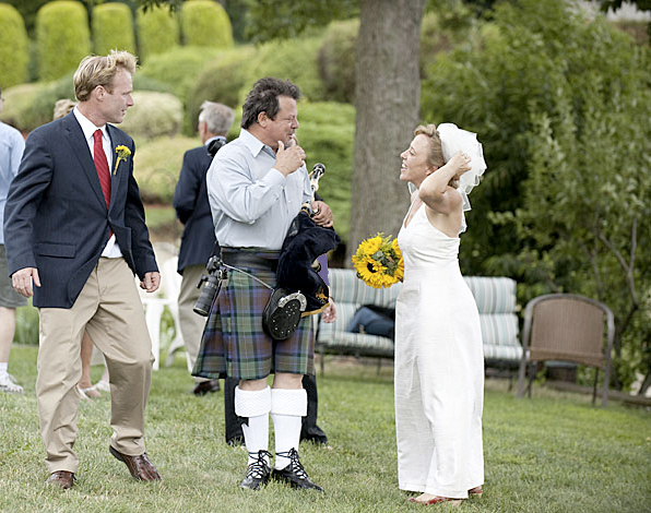 Tim Carey with his bagpipe talking to the bride