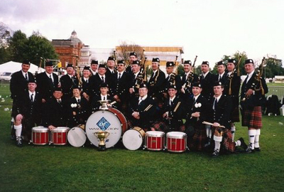 Tim Carey at Wold Championship with other bagpipers